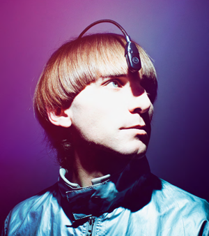 A bronze sculpture of Neil Harbisson with his eyeborg antenna. The antenna goes from inside the back of his head to hanging over his forehead.